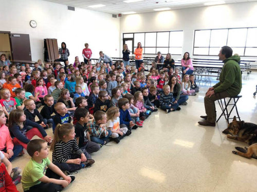 photo of erik presenting to elementary students in spirit lake, iowa.