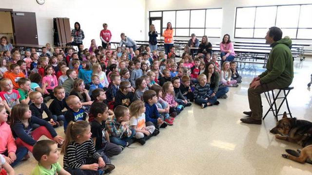photo of erik presenting to elementary students in spirit lake, iowa.