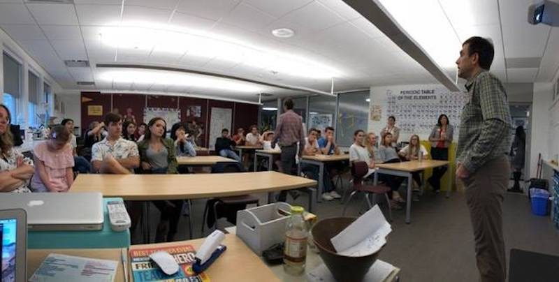 photo of erik weihenmayer speaking to students in the classroom at saint michaels academy