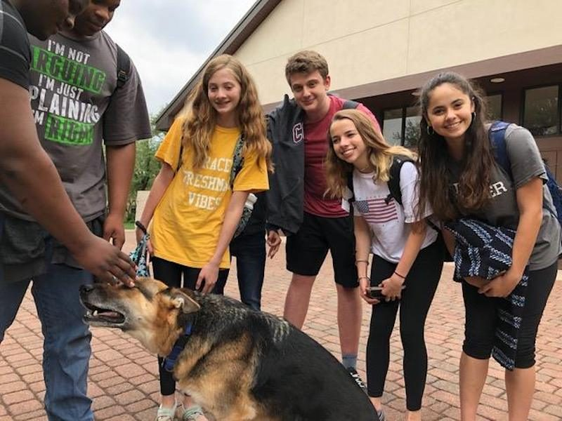 a photo of students with eriks guide dog uri