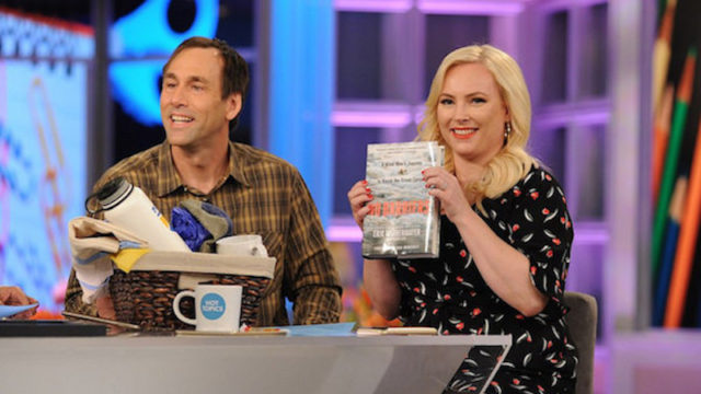 a photo of erik weihenmayer on the tv show the view with megan mccain who is holding up a copy of his book no barriers