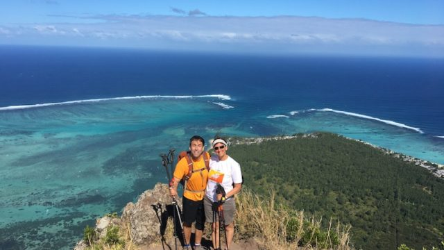 photo of erik weihenmayer and wife ellie on cliff overlooking ocean post hike