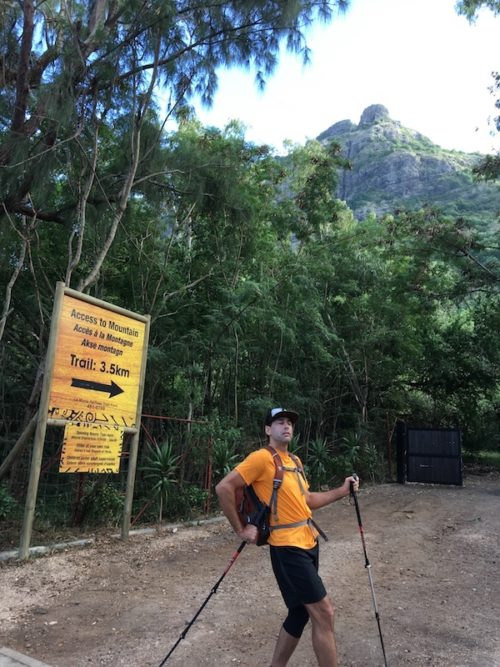 a photo of erik weihenmayer at trailhead in front of sign