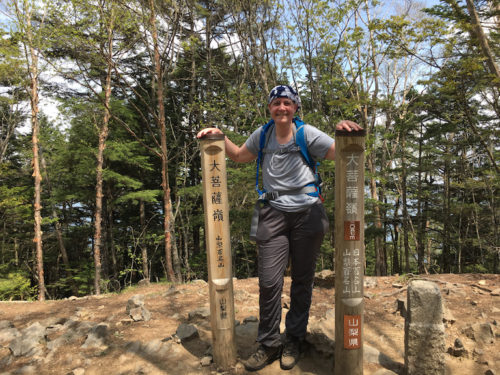 a photo of susan on the summit of mount daibosatsu her second mountain which she climbed almost a month to the day after finishing chemotherapy for breast cancer