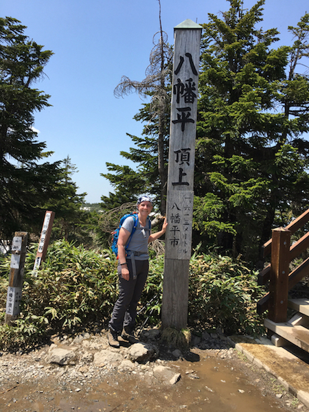 a photo of susan on the summit of mount hachimantai