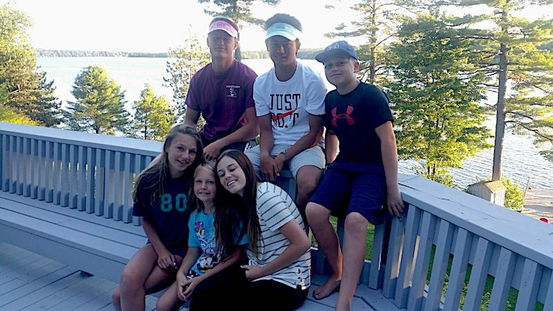 a photo of eriks family on the porch in nh