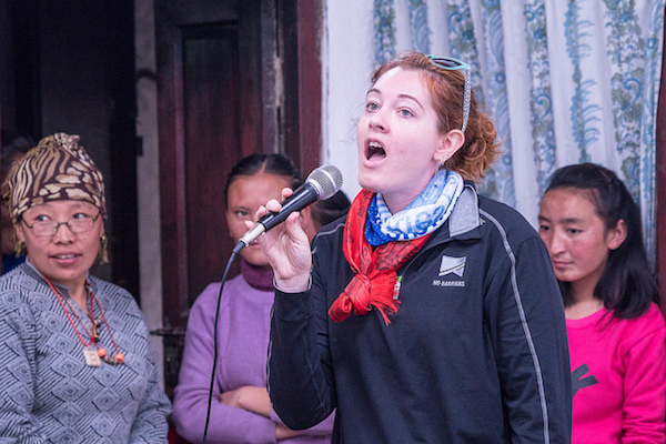 a photo of mandy harvey singing into a microphone in nepal