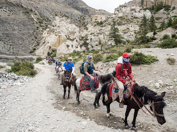 a photo of participants on horseback en route to mustang nepal