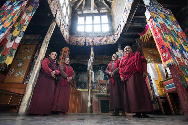 a photo of monks at the mukinath monastery