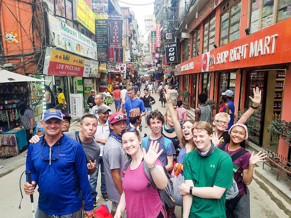 a photo of the team in one of the very busy streets in kathmandu nepal