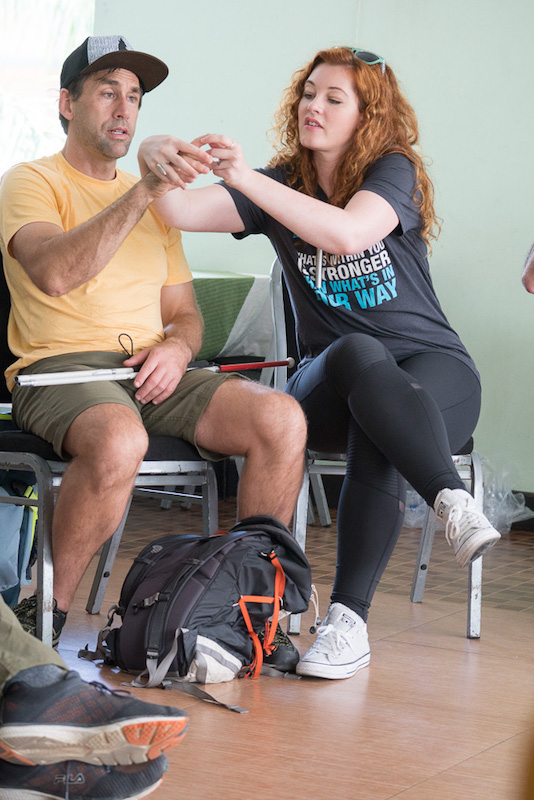 a photo of deaf musician mandy harvey giving erik weihenmayer sign language lessons