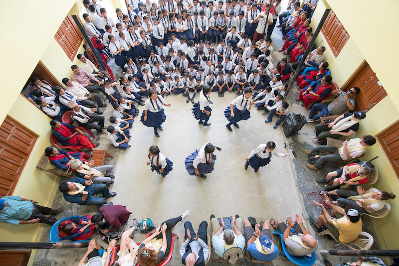 a photo of the students at the srijana school for the deaf performing a traditional dance