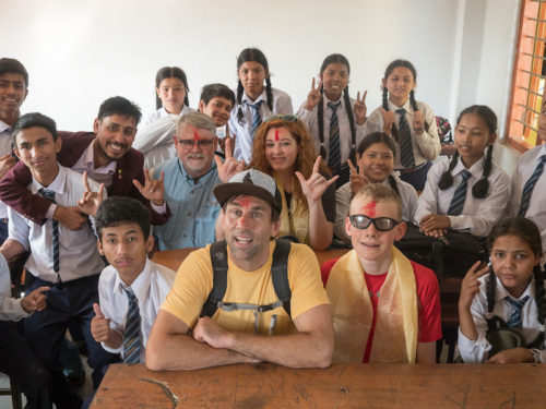 a photo of erik and participants with the students at srijana school for the deaf in nepal