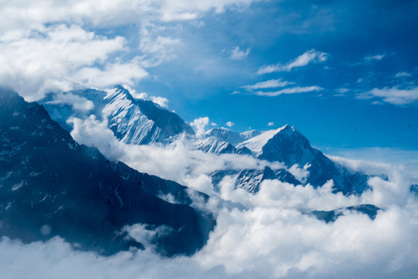 a photo of mountain peaks taken from the plane window in nepal