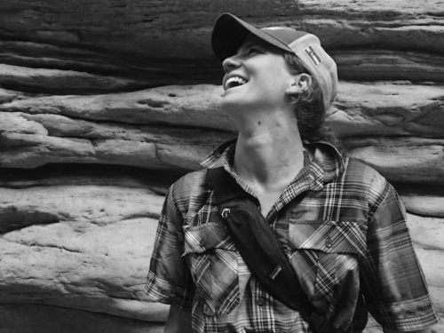 a photo of erin agee looking up and laughing taken at the grand canyon