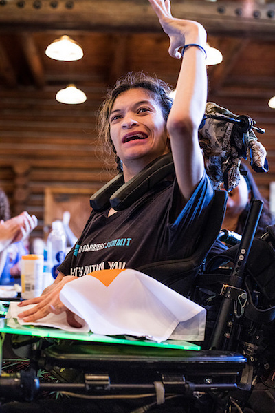 a photo of lauren in a wheelchair smiling at whats your everest 2018