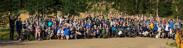 a photo of the entire group of whats your everest 2018 participants waving their arms in air