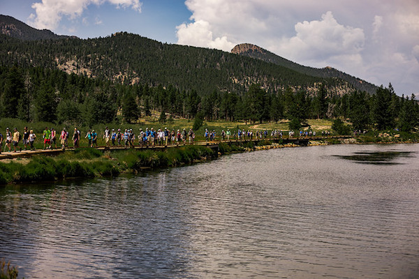 a photo of the group hiking besides lake lily in estes park