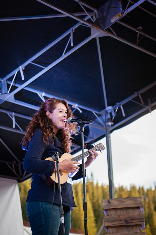 a photo of singer mandy harvey on stage with her ukelele
