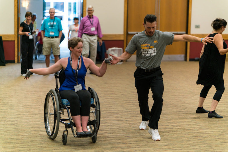a photo of nerissa salsa dancing during a clinic at the no barriers summit in 2016