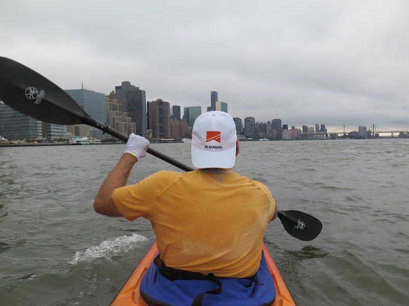 a photo of erik weihenmayer kayaking around manhattan on the hudson river