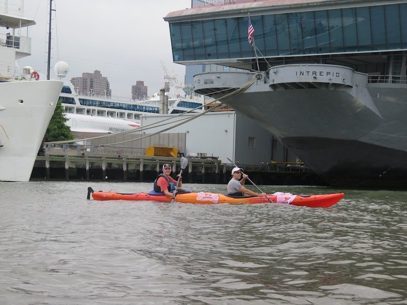 a photo erik weihenmayer kayaking at pier 84 and by the intrepid where the 2018 no barriers summit will be hosted