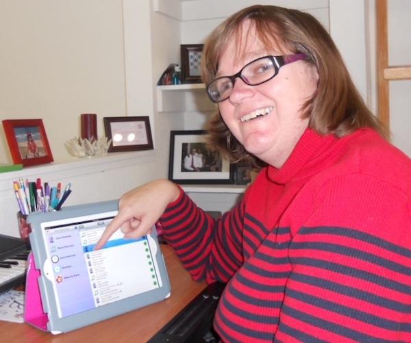 a photo of kara brouhard with her ipad