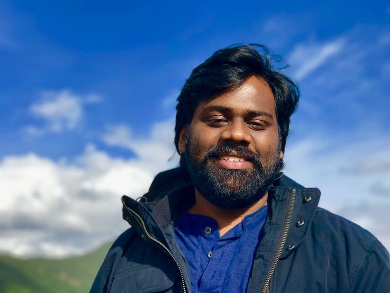 a photo of sanjay nediyara against a blue sky