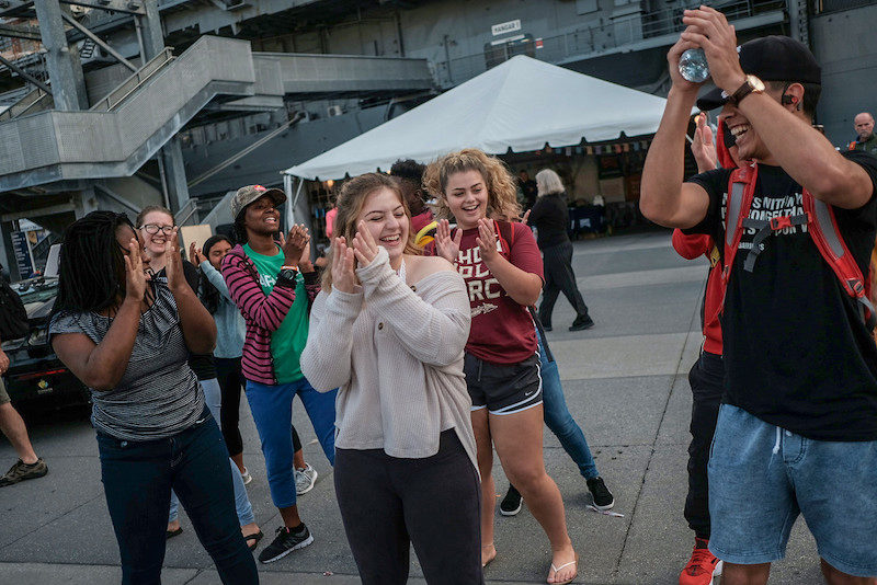 a photo of young women dancing on the intrepid during the no barriers summit 2018