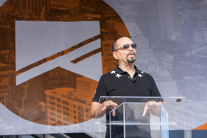 a photo of ice t speaking at the no barriers summit in nyc