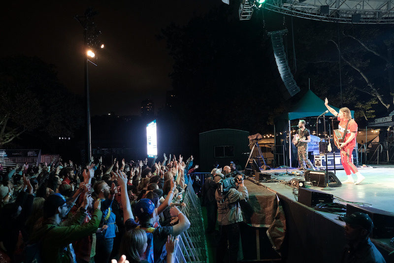 a photo of judah and the lion playing to fans in central park during no barriers summit closing ceremony