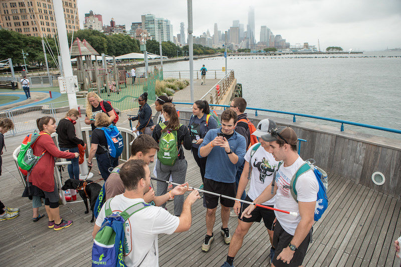 a photo of folks enjoying their time at the questival in nyc as part of the no barriers summit