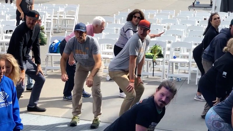 a photo of erik twerking at the no barriers summit