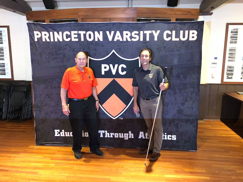 a photo of ed weihenmayer and erik weihenmayer in front a banner that says princeton varsity club at princeton university