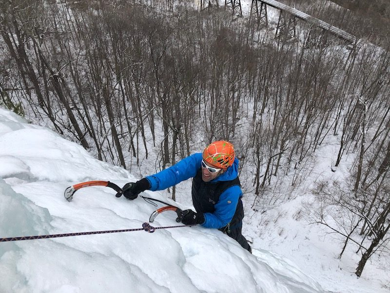 a photo of erik weihenmayer ice climbing in new hampshire on smear route