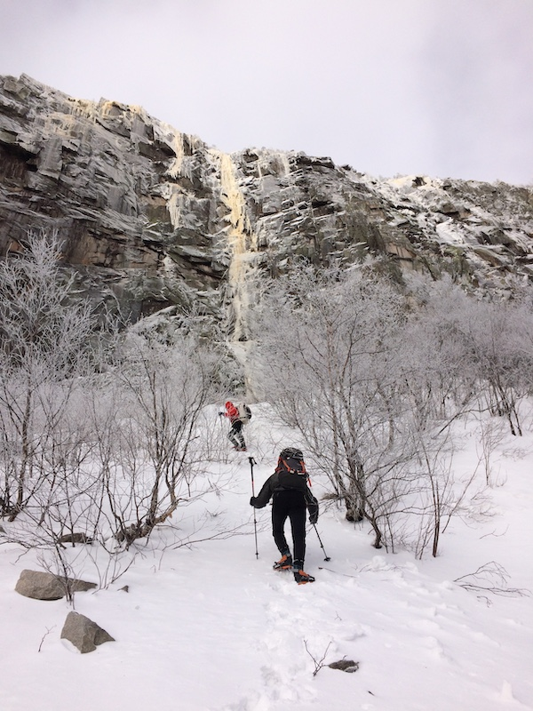 a photo of erik and mark richey approaching the ice route omega in new hampshire