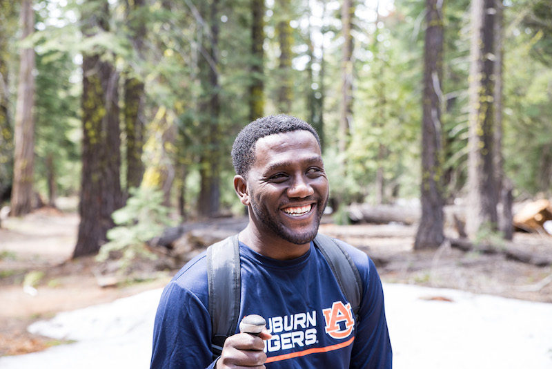 a photo of ethan johnston smiling at the summit in tahoe