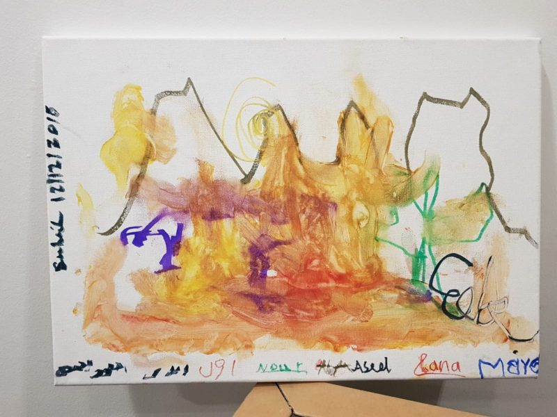 a photo of an abstract watercolor painting by blind kids in jordan