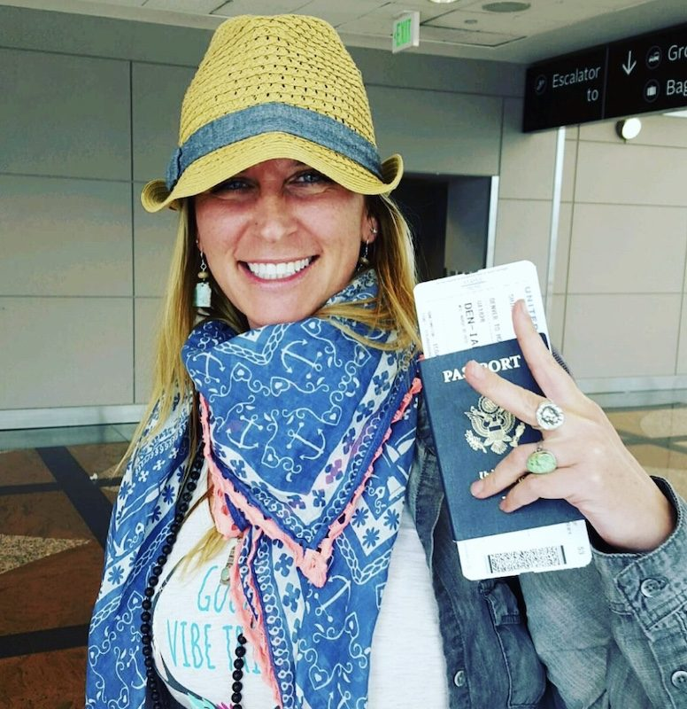 a photo of angie holding up her passport