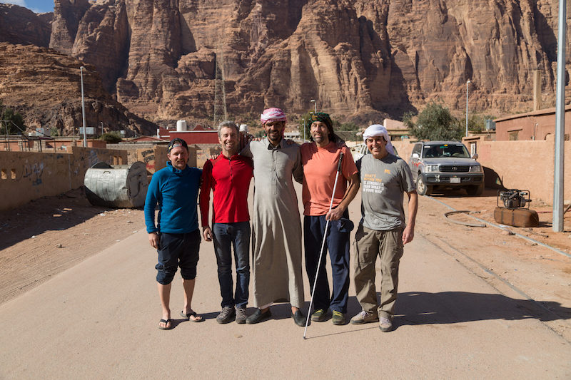 a photo of 5 men in the desert