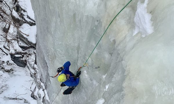 a photo of erik on an ice climbing face called goats foot