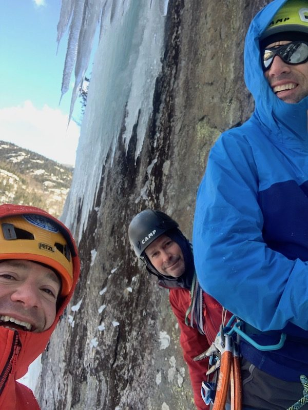 a photo of three guys smiling on an ice face