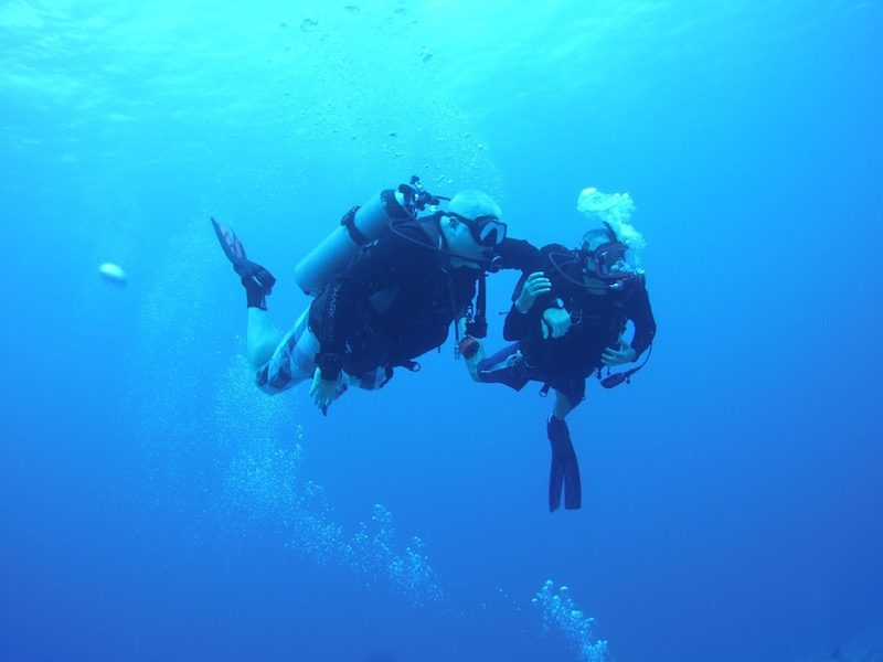jody and his guide underwater scuba diving