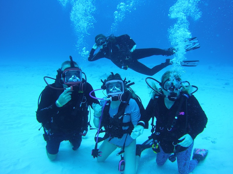 a photo of jody and his family posing for a photo underwater